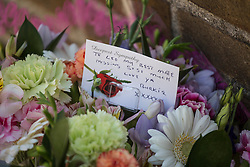© licensed to London News Pictures. London, UK 27/07/2013. Flowers and cards left for the man who was found stabbed in Poplar, east London.The victim, believed to be aged in his early 30s,  was announced dead on Friday, July 26 night. The Metropolitan Police said two men have been arrested on suspicion of murder following the investigation. Photo credit: Tolga Akmen/LNP