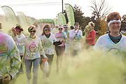 The Color Run 5K appeals to all ages and abilities.  The race is open to walkers, children, and strollers, among others besides runners. Photos by Elizabeth Held