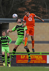 Braintree Town's Remy Clerima wins the high ball against Forest Green Rovers's Aarran Racine - Photo mandatory by-line: Nizaam Jones - Mobile: 07966 386802 - 14/03/2015 - SPORT - Football - Nailsworth - The New Lawn - Forest Green Rovers v Braintree  - Vanarama Football Conference.