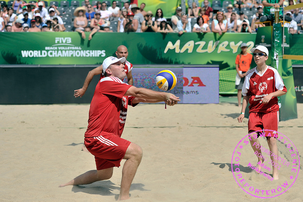 Pawel Papke receives the ball while exhibition match of Special Olympics Poland during Day 7 of the FIVB World Championships on July 7, 2013 in Stare Jablonki, Poland. <br /> <br /> Poland, Stare Jablonki, July 07, 2013<br /> <br /> Picture also available in RAW (NEF) or TIFF format on special request.<br /> <br /> For editorial use only. Any commercial or promotional use requires permission.<br /> <br /> Mandatory credit:<br /> Photo by &copy; Adam Nurkiewicz / Mediasport