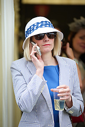 LIVERPOOL, ENGLAND - Friday, April 4, 2014: A racegoer during Ladies' Day on Day Two of the Aintree Grand National Festival at Aintree Racecourse. (Pic by David Rawcliffe/Propaganda)
