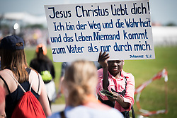 "28 May 2017, Wittenberg, Germany: On 28 May, students of the Global Ecumenical Theological Institute 2017 (GETI'17) joined tens of thousands of Christians in attending the closing service of Kirchentag (""Church Festival"") in Wittenberg, the place where the Reformation began 500 years ago. With a peak temperature of 33 degrees Celsius, it was a demanding but joyful experience. Meeting in Berlin on 19 May - 1 June 2017, the Global Ecumenical Theological Institute 2017 (GETI'17) gathers young Christian theologians from Europe and around the world to study and experience horizons of an ecumenical theology and ecclesiology. GETI'17 is organized under the patronage of the Conference of European Churches, and works under three key themes: Reforming Theology, Migrating Church, and Transforming Society."