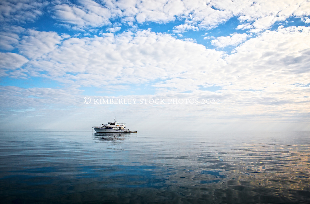 "Charter boat ""Kimberley Escapee"" at anchor near Adele Island.  Adele is the most remote of the islands in the Buccaneer Archiepelago and an important site for nesting seabirds.  It is also surrounded by an extensive reef system."