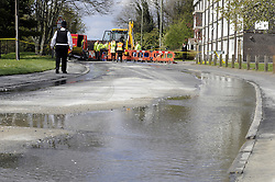 © Licensed to London News Pictures. 17/04/2012.A burst water main in St Mary Cray,Kent is causing problems as roads are closed and 70 homes are left without water.The burst happened at the junction between Elizabeth Way and High Street. Thames water  have turned off water in the broken pipe, which interupted supplies to 70 homes. The burst pipe caused the road to be blow upwards above the pavement..Photo credit : Grant Falvey/LNP
