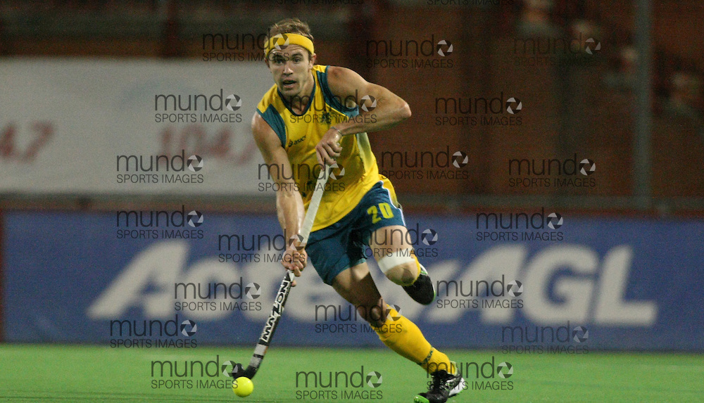 (Canberra, Australia---29 March 2012) Matt Swann of the Australia Kookaburra national field hockey team playing in the first of a three game test series against Japan. 2012 Copyright Photograph Sean Burges / Mundo Sport Images.