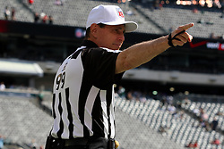 Sept 30, 2012; East Rutherford, NJ, USA; referee Tony Corrente (99) acknowledges fans before the game between the New York Jets and the San Francisco 49ers at MetLIfe Stadium.