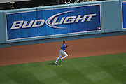 LOS ANGELES - MAY 03:  A player jogs near the warning track prior to the Los Angeles Dodgers game against the San Diego Padres at Dodger Stadium on Sunday, May 3, 2009 in Los Angeles, California.  The Dodgers won their 10th straight home game while defeating the Padres 7-3.  (Photo by Paul Spinelli/MLB Photos)