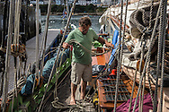 Luke Powell aboard the Agnes, a 46' pilot cutter that he built himself, after the conclusion of a massive maritime parade on Monday, July 25, 2016 in Douarnenez, France.