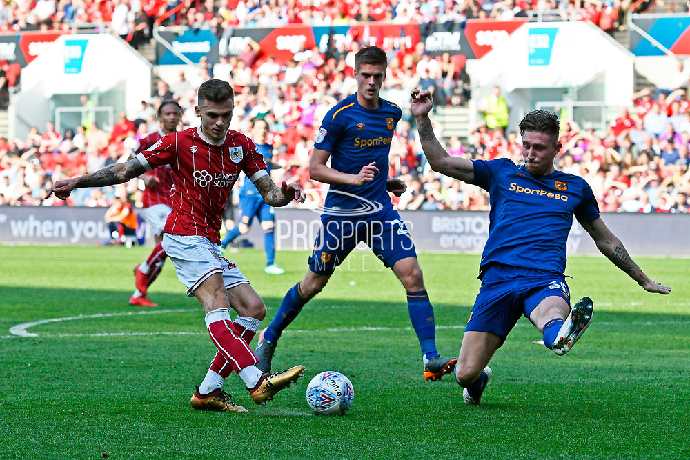 Jamie Paterson (20) of Bristol City shoots at goal but his shot is blocked by Angus MacDonald (50) of Hull City during the EFL Sky Bet Championship match between Bristol City and Hull City at Ashton Gate, Bristol, England on 21 April 2018. Picture by Graham Hunt.