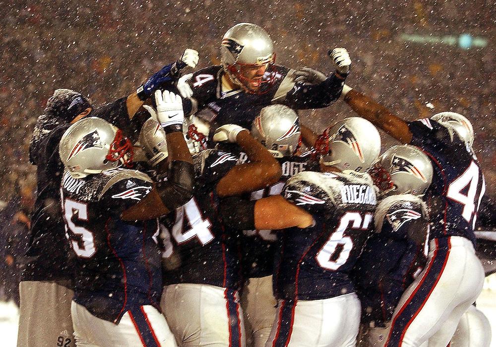 """adfrg""""Untitled"""" Patriots vs. Raiders at Foxboro Stadium. Patriots lift Adam Vinatieri after he kicked the winning field goal in OT."""