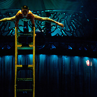 London, UK - 4 January 2012: Acrobat perform a balancing act on a chair tower during the Cirque Du Soleil Kooza dress rehearsal at the Royal Albert Hall. Since its premiere in April of ..2007, KOOZA has captivated close to four million spectators in North America and Japan.  London will be the first destination of the KOOZA European tour starting the ..5th of January. Written and directed by David Shiner, KOOZA is a return to the origins of Cirque du Soleil combining two circus traditions - acrobatic performance and ..the art of clowning.  KOOZA highlights the physical demands of human performance in all its splendor and fragility, presented in a colorful m&eacute;lange that emphasizes ..bold slapstick humor. This image can be quickly and easily purchased from some of the major international stock agencies:<br />