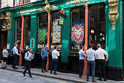 Lunchtime City workers watch 'the Ashes' cricket match between England and Australia being streamed in the 'Pavillion End' pub on Watling Street (the former Roman thoroughfare) in the City of London, the capital's financial district (aka the Square Mile), on 22nd August 2019, in London, England.