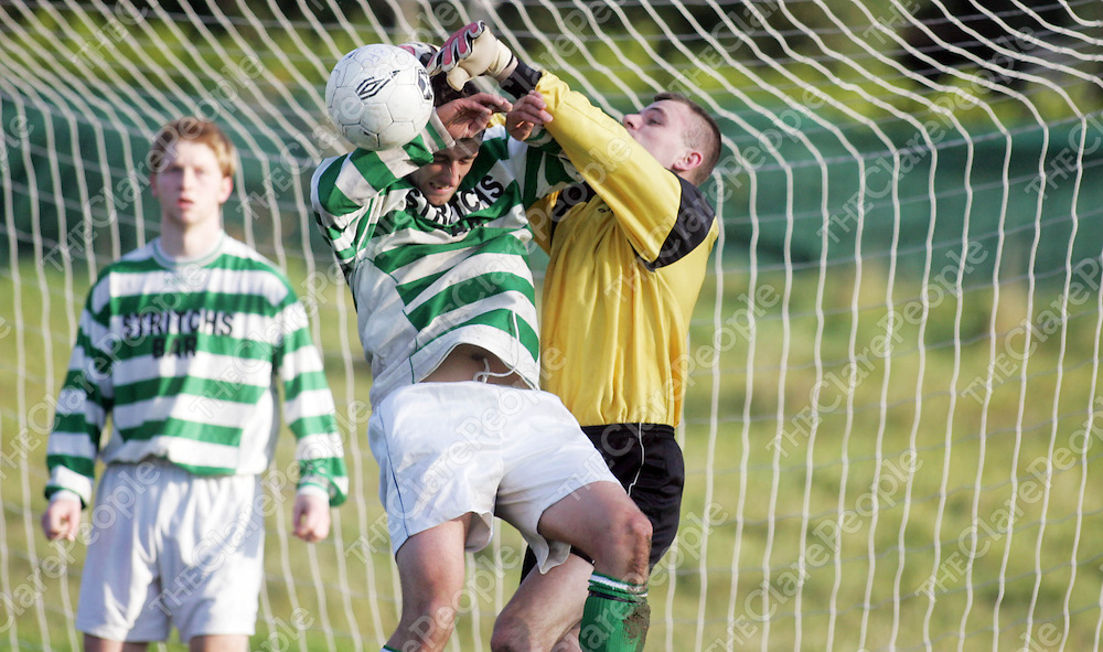 Bridge Celtic's Ricky Mowate and goalkeeper Adrian Douigh jump for the dropping ball in thier meeting with Bunratty in Bunratty on Sunday. Pic. Brian Arthur/ Press 22.