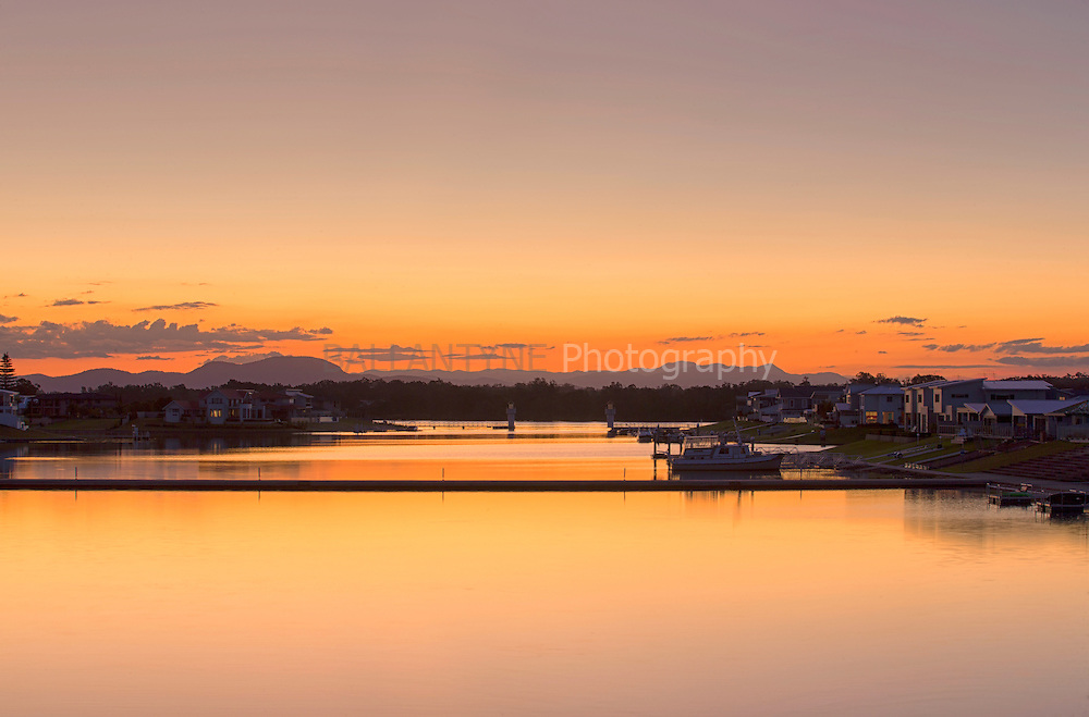 Sunsets on the last day of Autumn 2016, over Settlement City Canals, Port Macquarie, New South Wales, Australia