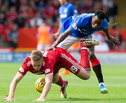 Aberdeen's Lewis Ferguson (left) and Rangers Lassana Coulibaly (right) during the Scottish Ladbrokes Premiership match at Pittodrie Stadium, Aberdeen.