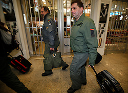 German Luftwaffe personnel arrive from Tripoli at Malta International Airport outside Valletta early February 23, 2011. Two German Luftwaffe C-160 Transall transport planes landed in Malta late Tuesday night evacuating sixty German civilians from Libya, sources said..Photo by Darrin Zammit Lupi