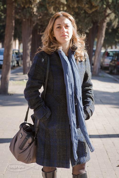 Taranto, Tamburi, Feb. 2016 - Maria Teresa D'Amato di Taranto Lider, insegnante alla scuola del  quartiere Tamburi, uno dei più colpiti dalla polvere rossa dell'ILVA.