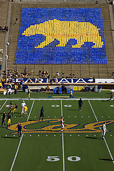 October 24, 2009; Berkeley, CA, USA;  Player from the California Golden Bears and the Washington State Cougars warm up at midfield before the game at Memorial Stadium.