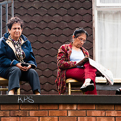 London, UK - 27 August 2012: spectators watch the  parade during the annual Notting Hill Carnival.
