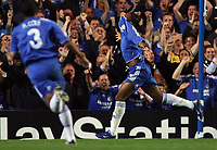 Photo: Paul Thomas.<br /> Chelsea v Barcelona. UEFA Champions League, Group A. 18/10/2006.<br /> <br /> Didier Drogba (R) of Chelsea celebrates his goal.