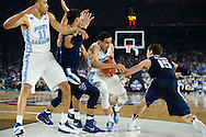 04 APR 2016: Guard Marcus Paige (5) of the University of North Carolina splits Guard Josh Hart (3) and Guard Ryan Arcidiacono (15) of Villanova University during the 2016 NCAA Men's Division I Basketball Final Four Championship game held at NRG Stadium in Houston, TX. Villanova defeated North Carolina 77-74 to win the national title. Brett Wilhelm/NCAA Photos