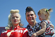 A portrait of a young Rockabilly family, a couple and a toddler, Viva Las Vegas Festival, Las Vegas, USA 2006.