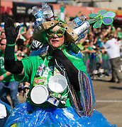 Amy Ewell waves to the crowd during the Dallas St. Patrick's Parade on Greenville Avenue, Saturday, March 16, 2013. (Cooper Neill/The Dallas Morning News)