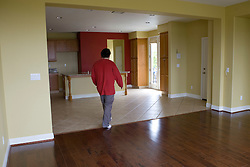 Homeowner walks quietly through his now empty home for the last time in of Vallejo, Calif. He lost his home in 2009 to foreclosure due to a combination of job loss, adjustable loan payments doubling and  home value under water nearly fifty percent. Photo by Kim Kulish