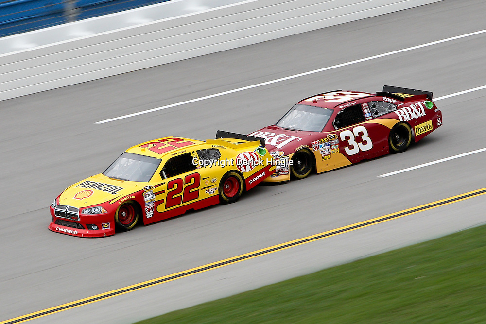 April 15, 2011; Talladega, AL, USA; NASCAR Sprint Cup Series driver Clint Bowyer (33) is bump drafts Kurt Busch (22) during practice for the Aarons 499 at Talladega Superspeedway.   Mandatory Credit: Derick E. Hingle
