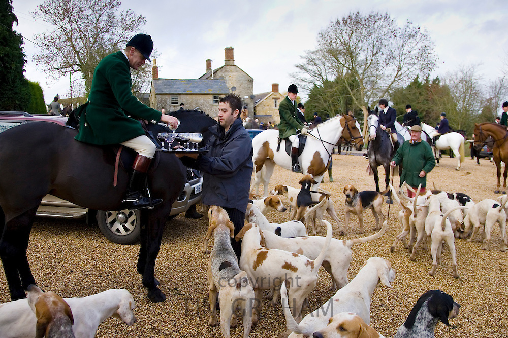 Members of Heythrop Hunt are offered traditional stirrup cup drinks at hunt meet, The Cotswolds, Oxfordshire
