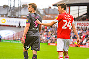 Leeds United forward Patrick Bamford (9) is held by Barnsley defender Aapo Halme (24) during the EFL Sky Bet Championship match between Barnsley and Leeds United at Oakwell, Barnsley, England on 15 September 2019.