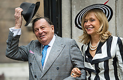 © London News Pictures. 05/03/2016. London, UK. BARRY HUMPHREYS and wife and wife LIZZIE attends a ceremony to mark the wedding of Rupert Murdoch and Jerry Hall held at St Brides Church on Fleet Street,  central London on February 05, 2016. . Photo credit: Ben Cawthra /LNP