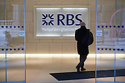 A man arrives at RBS bank headquarters, Bishopsgate. The City of London.