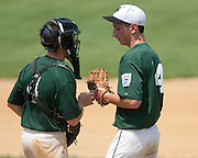 West Deptford's Danny Riley talks to catcher Keith Wallace before the start of the 6th inning during a elimination bracket game of the Eastern Regional Senior League tournament held in West Deptford on Monday, August 8.
