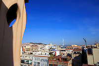 Looking out over the rooftops of Barcelona, Spain from the top of Casa Mila, the famous Antoni Gaudi designed building.