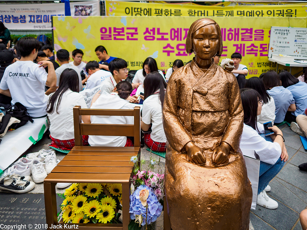 """SEOUL, SOUTH KOREA: The """"Pyeonghwabi"""" (""""Statue of peace"""") in front of the Japanese embassy in Seoul, surrounded by Koreans protesting to obtain justice from the Japanese for the sexual enslavement of Korean women during World War II. The bird on her shoulder is symbolic of freedom and peace. The Wednesday protests have been taking place since January 1992. Protesters want the Japanese government to apologize for the forced sexual enslavement of up to 400,000 Asian women during World War II. The women, euphemistically called """"Comfort Women"""" were drawn from territories Japan conquered during the war and many came from Korea, which was a Japanese colony in the years before and during the war. The """"comfort women"""" issue is still a source of anger of many people in northeast Asian areas like South Korea, Manchuria and some parts of China.         PHOTO BY JACK KURTZ   <br /> Wednesday Demonstration demanding Japan to redress the Comfort Women problems"""