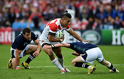 Male Sa'u of Japan takes on the Scotland defence - Mandatory byline: Patrick Khachfe/JMP - 07966 386802 - 23/09/2015 - RUGBY UNION - Kingsholm Stadium - Gloucester, England - Scotland v Japan - Rugby World Cup 2015 Pool B.