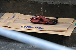 © Licensed to London News Pictures. 05/06/2018. London, UK. A glove is recovered as evidence outside Watches of Switzerland on Regent Street after it was attacked by a gang on mopeds. It is being reported that the attackers were armed with knives. Photo credit: Rob Pinney/LNP