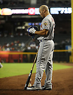 Jul. 26, 2012; Phoenix, AZ, USA; New York Mets outfielder Scott Hairston (12)  reacts during the game against the Arizona Diamondbacks at Chase Field. The Mets defeated the Diamondbacks 3-1. Mandatory Credit: Jennifer Stewart-US PRESSWIRE