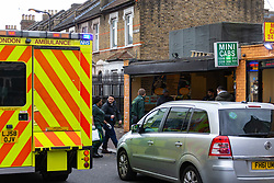 Police and ambulance service attend the scene of a stabbing on Bromley Road at the corner of Lee Bridge Road in Leyton, NE London.. London, January 09 2019.