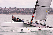 Scott Baker (NZL253), race one of the A Class World championships regatta being sailed at Takapuna in Auckland. 11/2/2014