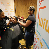 "Harolynn Shawber, left, and Chandra Pannell, right, stylists with non-profit ""Wear it Well"", give an onsite make over to Carolyn Senter, of Belden, during the Tupelo/Lee County Community Foundation's ""A night for a Hand Up"" event Tuesday night at the BancorpSouth Conference Center. Senter is a cancer survivor and ""Wear it Well"",gives makes overs for those cancer and other life threatening diseases. The event was held for non-profits to submit proposals for start-up projects and/or show expansion of programs and services. Each ticket holder to the event cast a vote for their favorite non-profit."