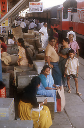 Passengers waiting on railway station platform at Cochin; Kerala; India,