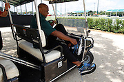 Monday, July 8, 2013 REGGIE WILLIAMS : Due to his many surgical procedure and having one leg longer then the other former Cincinnati Bengals player and Cincinnati City Councilman Reggie Williams removes his shoes when he it at rest. The extra weight from his special soul makes it uncomfortable to set his feet down while sitting. He returned for a visit to his old stomping grounds at the ESPN Wide World of Sports Complex on the Walt Disney property. He helped build the complex from the ground up and was one of Disney's first African American executives.  The Enquirer/Jeff Swinger