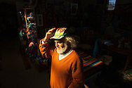 "Roger Josephson poses in a room he calls his ""color zone"" at his residence in The Plains, Ohio, Nov. 11, 2011. Josephson, who creates art in a variety of media, first started doing tie dye as a summer job while studying economics over 30 years ago and still gets requests for hats even though he hasn't made them in over a decade."
