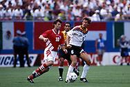 FIFA World Cup - USA 1994<br /> 10.7.1994, Giants Stadium, New York/New Jersey.<br /> World Cup Quarter Final, Bulgaria v Germany.<br /> Guido Buchwald (Germany) v Nasko Sirakov (Bulgaria). On the background referee José Joaquín Torres Cadena (Colombia).