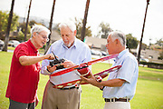 Senior Friends Enjoying Model Airplanes at the Park