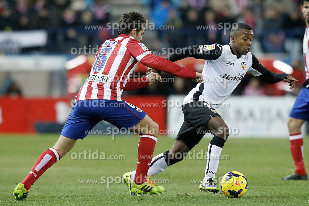 15.12.2013, Estadio Vicente Calderon, Madrid, ESP, Primera Division, Atletico Madrid vs FC Valencia, 16. Runde, im Bild Atletico de Madrid's Koke (l) and Valencia's Dorlan Pabon // Atletico de Madrid's Koke (l) and Valencia's Dorlan Pabon during the Spanish Primera Division 16th round match between Club Atletico de Madrid and Valencia CF at the Estadio Vicente Calderon in Madrid, Spain on 2013/12/15. EXPA Pictures &copy; 2013, PhotoCredit: EXPA/ Alterphotos/ Acero<br /> <br /> *****ATTENTION - OUT of ESP, SUI*****