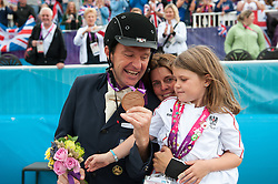 Individual bronze medalist Pepo Puch (AUT) celebrates with his wife Michele and child Lou-Charlotte - Individual Championship Test - Grade Ib - <br /> London 2012 Paralympic Games<br /> © Hippo Foto - Jon Stroud