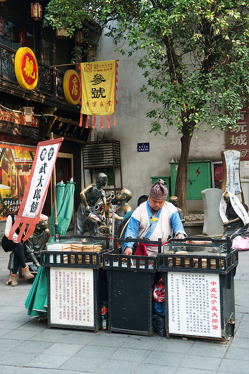 Street hawker in traditional japanese costume at Qinghefang ancient street